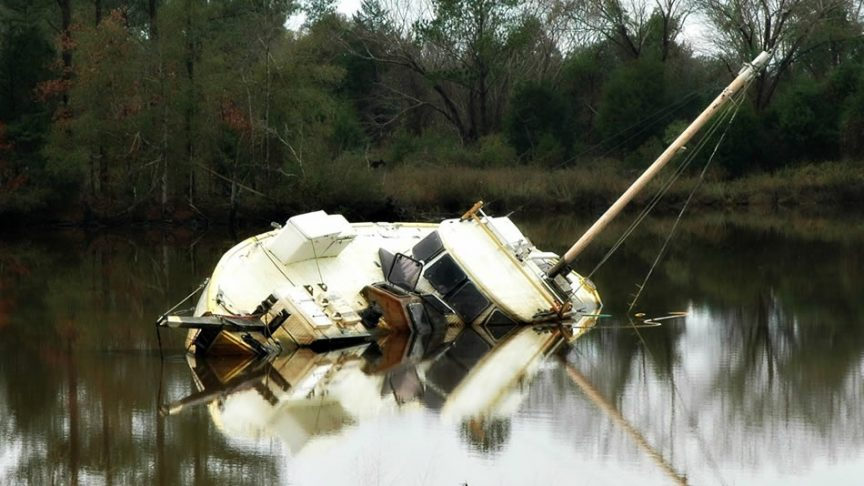 What causes a boat to sink